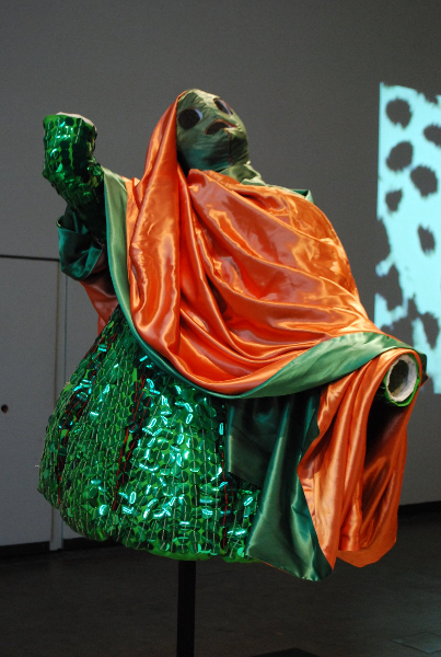 green-sequined-ensemble-worn-during-d-offay-exhibition_1988_cotton-sequin-shapes-satin-synthetic-wool-hood-and-eye-closure