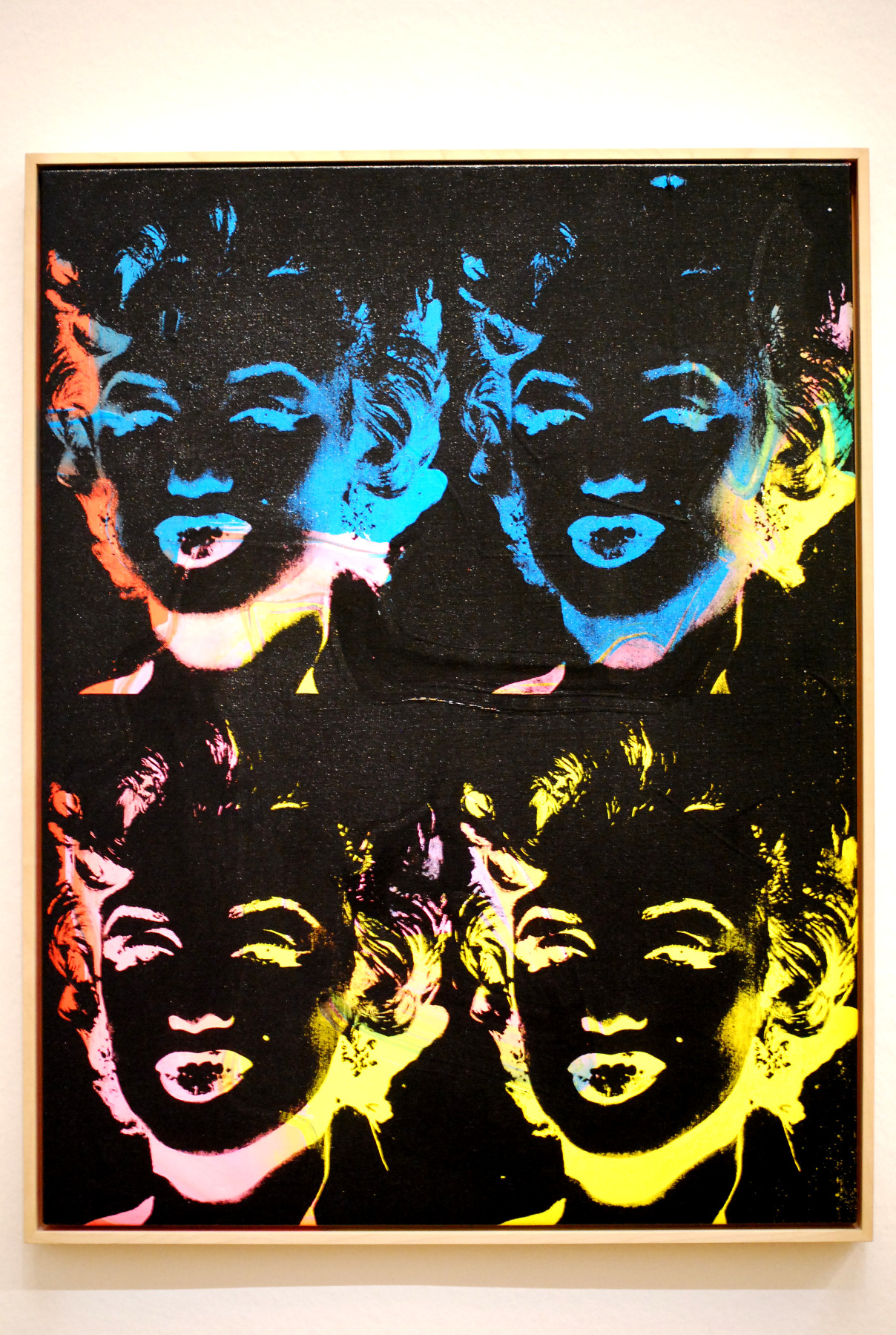 andy-warhol_four-multicoloured-marilyns_reversal-series_1979-1986_silkscreen-on-canvas